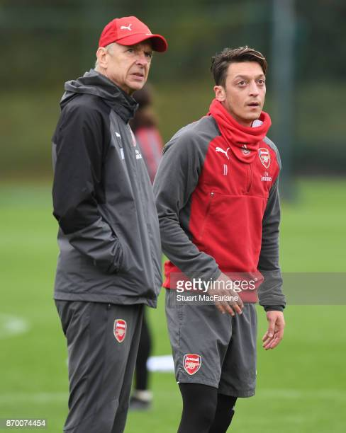 Arsenal manager Arsene Wenger talks to Mesut Ozil during a training session at London Colney on November 4 2017 in St Albans England