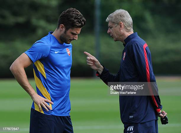 Arsenal manager Arsene Wenger talks to Olivier Giroud before a training session ahead of their UEFA Champions League Play Off second leg match...