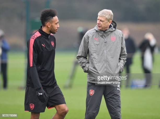 Arsenal manager Arsene Wenger talks to PierreEmerick Aubameyang during a training session at London Colney on February 21 2018 in St Albans England