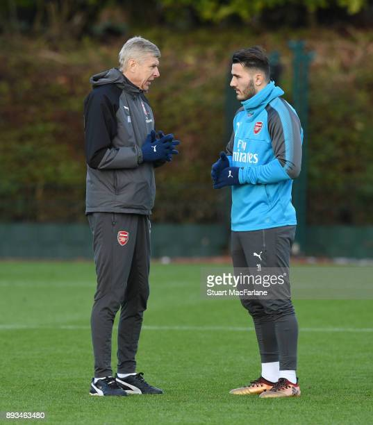Arsenal manager Arsene Wenger talks to Sead Kolasinac during a training session at London Colney on December 15 2017 in St Albans England