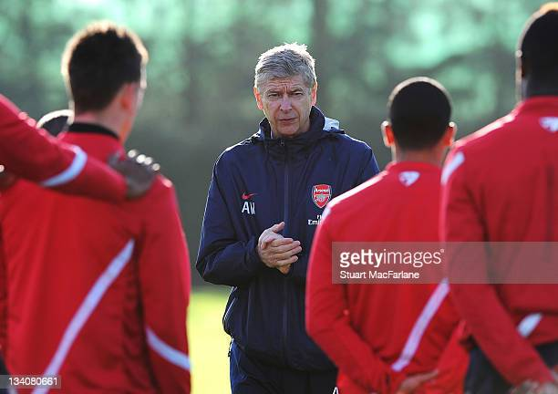 Arsenal manager Arsene Wenger talks to the squad before a training session at London Colney on November 25 2011 in St Albans England