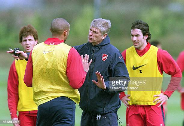 Arsenal manager Arsene Wenger talks to Thierry Henry during a training session on May 6 2005 in London England