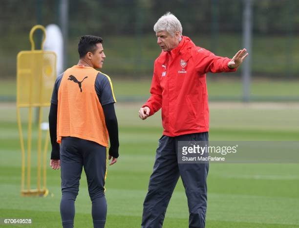 Arsenal manager Arsene Wenger talks with Alexis Sanchez during a training session at London Colney on April 20 2017 in St Albans England