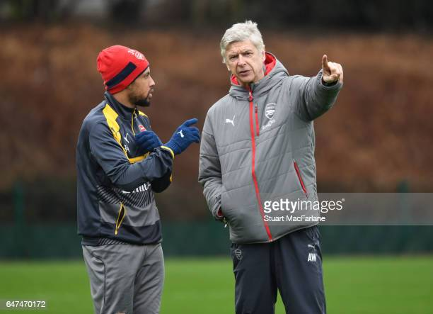 Arsenal manager Arsene Wenger talks with Francis Coquelin during a training session at London Colney on March 3, 2017 in St Albans, England.