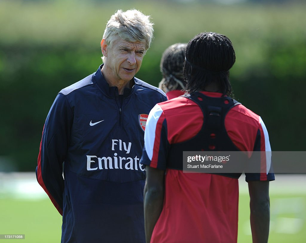 Arsenal manager Arsene Wenger talks with Gervinho during a training session at London Colney on July 09, 2013 in St Albans, England.