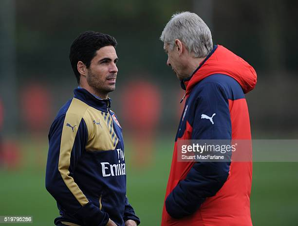 Arsenal manager Arsene Wenger talks with Mikel Arteta during a training session at London Colney on April 8 2016 in St Albans England
