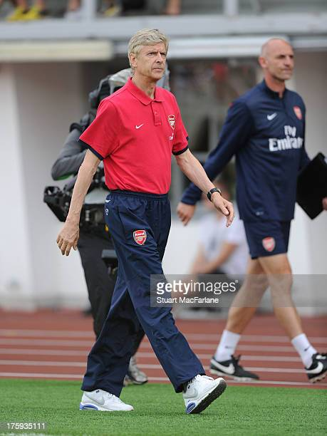 Arsenal manager Arsene Wenger walks off the pitch at half time during the preseason friendly match between Arsenal and Manchester City at the Olympic...