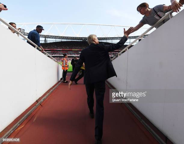 Arsenal manager Arsene Wenger walks to the pitch before the Premier League match between Arsenal and West Ham United at Emirates Stadium on April 22...