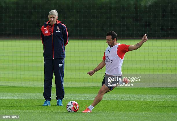 Arsenal manager Arsene Wenger watches Santi Cazorla during a training session at London Colney on September 18 2015 in St Albans England