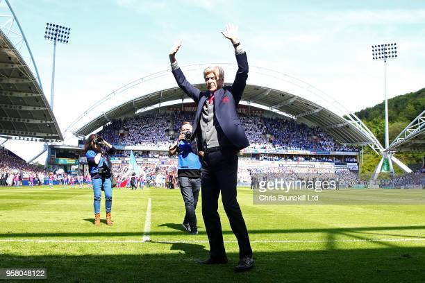 Arsenal manager Arsene Wenger waves to the supporters ahead of the Premier League match between Huddersfield Town and Arsenal at John Smith's Stadium...