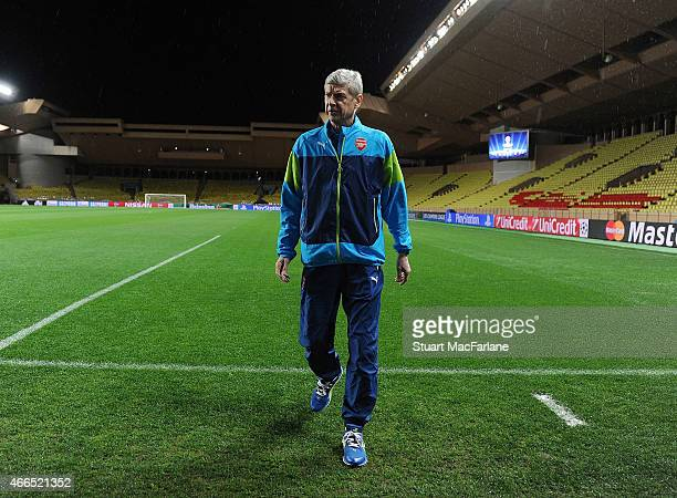 Arsenal manager Arsene Wenger, who was once manager of AS Monaco, walks on the pitch at Stade Louis II ahead of their match against Monaco tomorrow...
