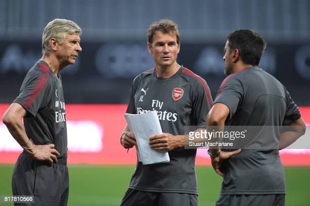 Arsenal manager Arsene Wenger with 2st team coach Jens Lehmann and Sal Bibbo before a training session at the Shanghai Stadium on July 18 2017 in...