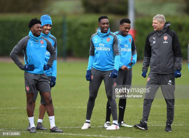 Arsenal manager Arsene Wenger with Ainsley MaitlandNiles PierreEmerick Aubameyang Danny Welbeck and Joe Willock during a training session at the...