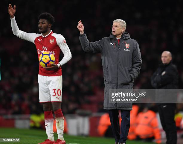 Arsenal manager Arsene Wenger with Ainsley MaitlandNiles during the Premier League match between Arsenal and Newcastle United at Emirates Stadium on...