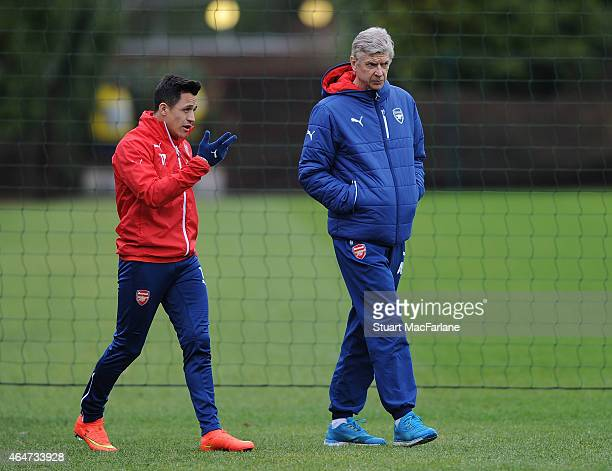 Arsenal manager Arsene Wenger with Alexis Sanchez before a training session at London Colney on February 28 2015 in St Albans England