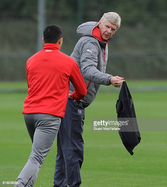 Arsenal manager Arsene Wenger with Alexis Sanchez during a training session at London Colney on October 21 2016 in St Albans England