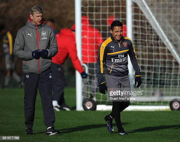 Arsenal manager Arsene Wenger with Alexis Sanchez during a training session at London Colney on January 18 2017 in St Albans England