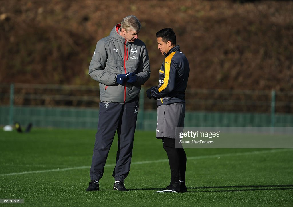 Arsenal manager Arsene Wenger with Alexis Sanchez during a training session at London Colney on January 18, 2017 in St Albans, England.