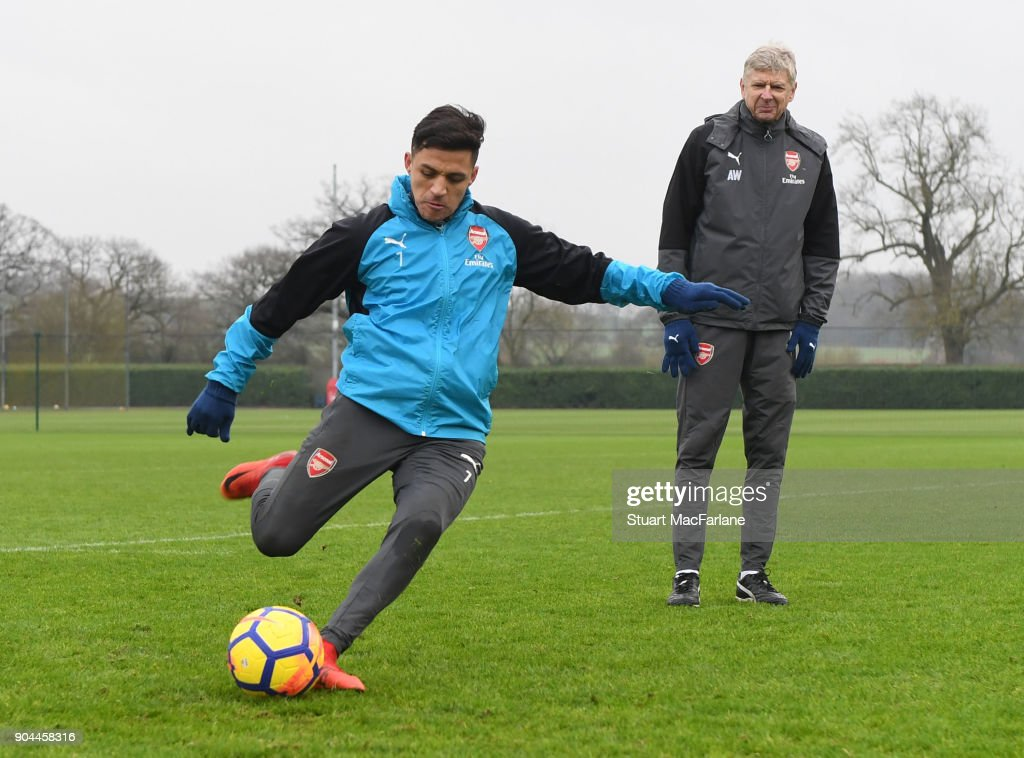 Arsenal manager Arsene Wenger with Alexis Sanchez during a training session at London Colney on January 13, 2018 in St Albans, England.
