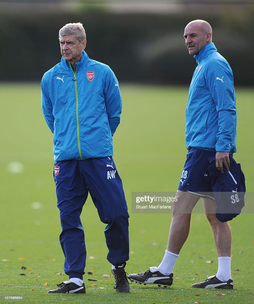 Arsenal manager Arsene Wenger with Assistant Manager Steve Bould during a training session at London Colney on October 21, 2014 in St Albans, England.