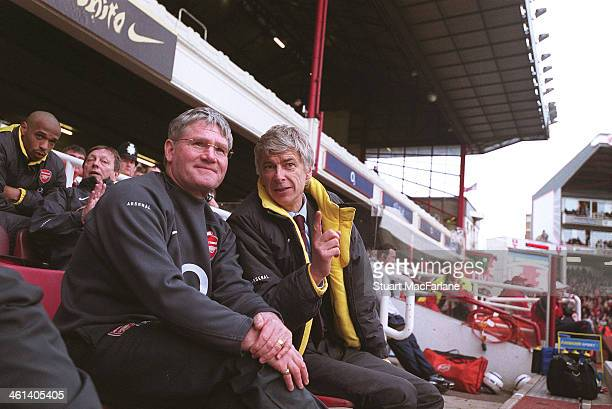 Arsenal manager Arsene Wenger with assistant Pat Rice during the match between Arsenal and Aston Villa at Arsenal Stadium Highbury on April 1 2006 in...