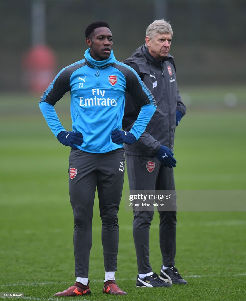Arsenal manager Arsene Wenger with Danny Welbeck during a training session at London Colney on January 9, 2018 in St Albans, England.