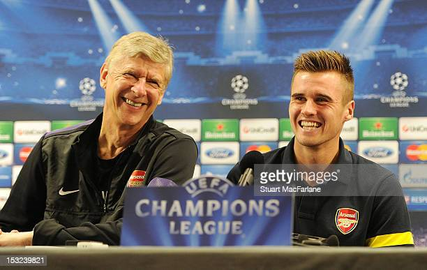 Arsenal manager Arsene Wenger with defender Carl Jenkinson during a Press conference at London Colney on October 2, 2012 in St Albans, England.