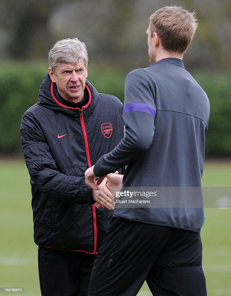 Arsenal manager Arsene Wenger with defender Per Mertesacker before a training session at London Colney on March 15, 2013 in St Albans, England.