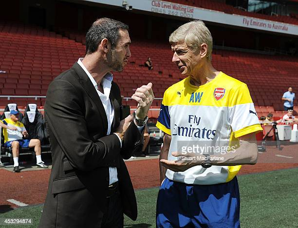 Arsenal manager Arsene Wenger with ex player Martin Keown share a conversation during a training session at Emirates Stadium on August 7 2014 in...