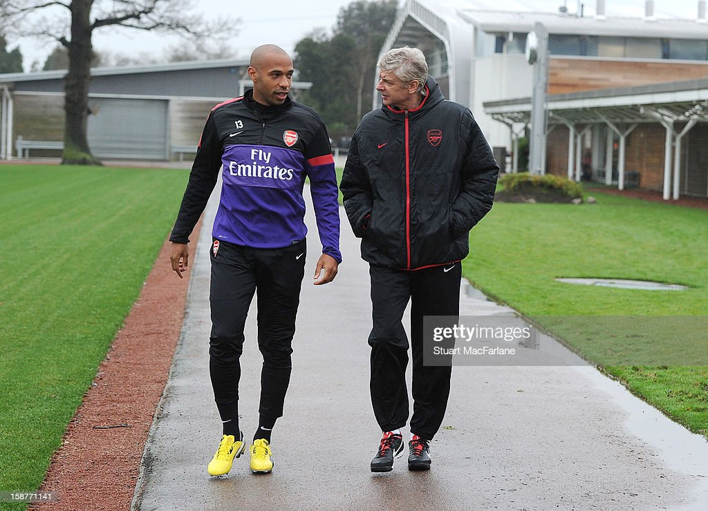 Arsenal manager Arsene Wenger with ex player Thierry Henry before a training session at London Colney on December 28, 2012 in St Albans, England.