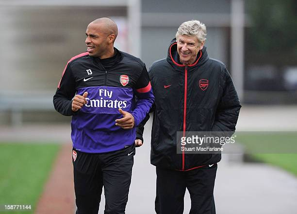 Arsenal manager Arsene Wenger with ex player Thierry Henry before a training session at London Colney on December 28 2012 in St Albans England