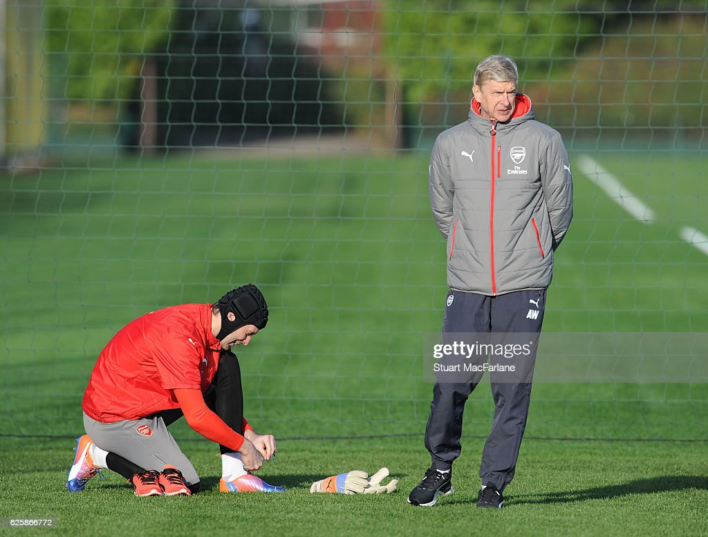 Arsenal manager Arsene Wenger with goalkeeper Petr Cech before a training session in preparation for the Premier League match against AFC Bournemouth at London Colney on November 26, 2016 in St Albans, England.