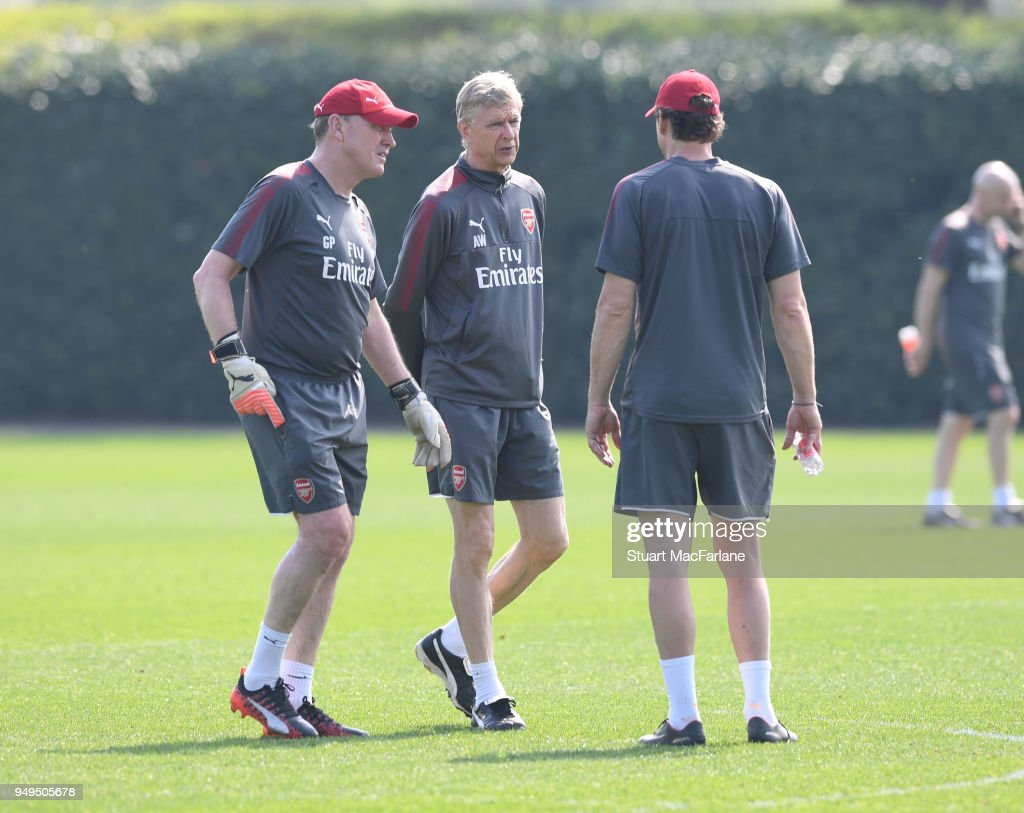 Arsenal manager Arsene Wenger with (L) goalkeeping coach Gerry Peyton and (R) 1st team coach Jens Lehmann during a training session at London Colney on April 21, 2018 in St Albans, England.