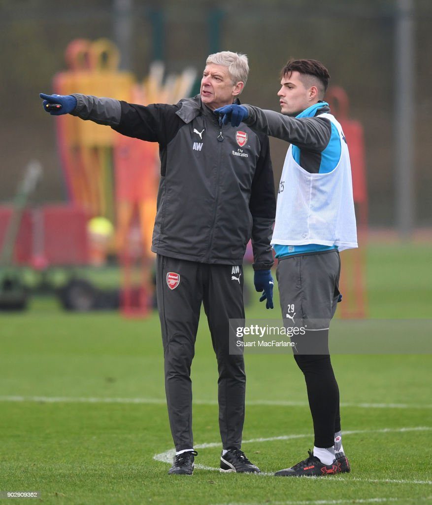 Arsenal manager Arsene Wenger with Granit Xhaka during a training session at London Colney on January 9, 2018 in St Albans, England.