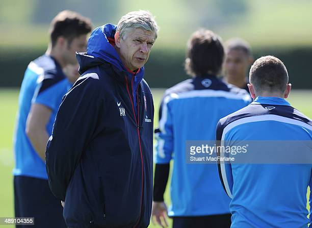 Arsenal manager Arsene Wenger with Jack Wilshere before a training session at London Colney on May 10 2014 in St Albans England