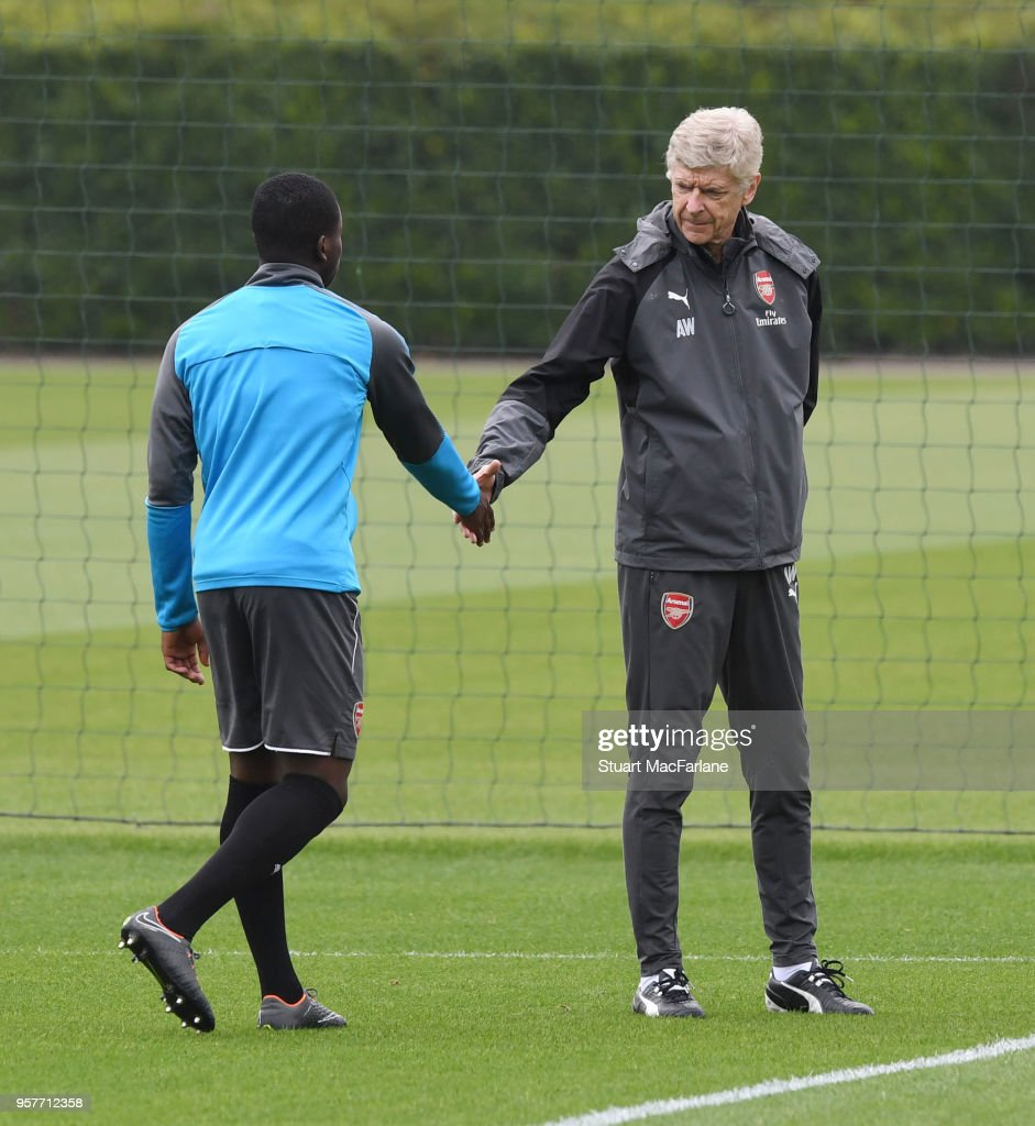 Arsenal manager Arsene Wenger with Jordi Osei-Tutu before a training session at London Colney on May 12, 2018 in St Albans, England.