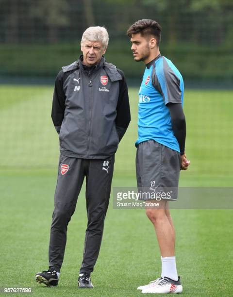 Arsenal manager Arsene Wenger with Konstantinos Mavropanos during a training session at London Colney on May 12 2018 in St Albans England