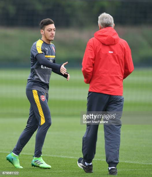 Arsenal manager Arsene Wenger with Mesut Ozil before a training session at London Colney on May 6 2017 in St Albans England