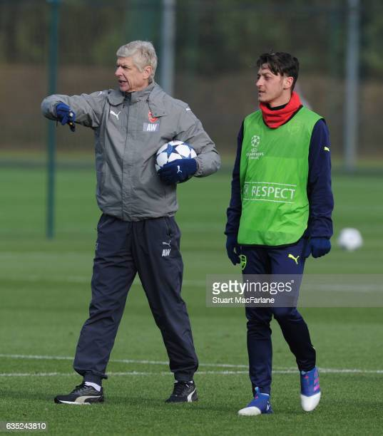 Arsenal manager Arsene Wenger with Mesut Ozil during a training session at London Colney on February 13, 2017 in St Albans, England.