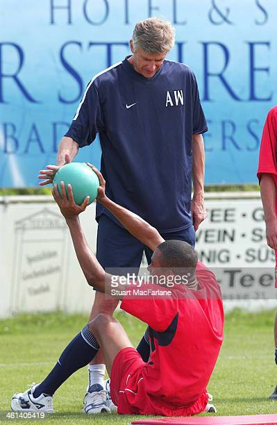 Arsenal manager Arsene Wenger with new signing Gilberto during a training session at Arsenal's pre season training camp on July 30 2002 in Bad...