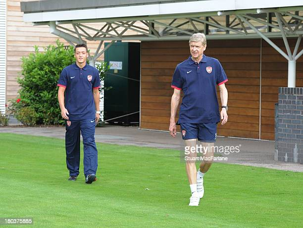 Arsenal manager Arsene Wenger with new signing Mesut Oezil at London Colney on September 12, 2013 in St Albans, England.