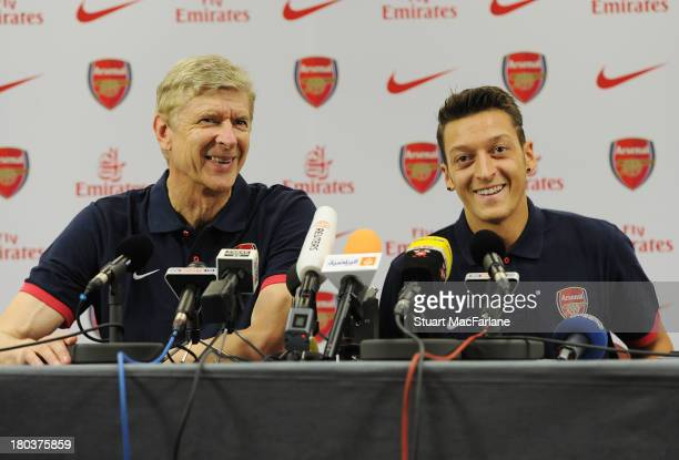 Arsenal manager Arsene Wenger with new signing Mesut Oezil attend a press conference at London Colney on September 12 2013 in St Albans England