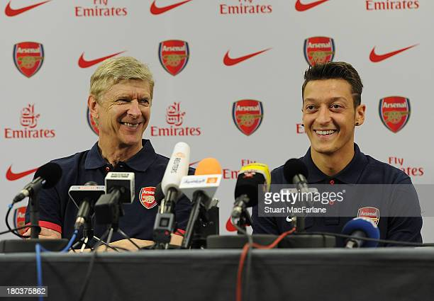 Arsenal manager Arsene Wenger with new signing Mesut Oezil attend a press conference at London Colney on September 12, 2013 in St Albans, England.