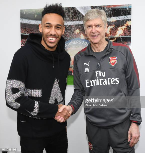 Arsenal manager Arsene Wenger with new signing PierreEmerick Aubameyang at London Colney on January 31 2018 in St Albans England
