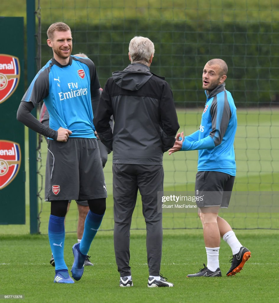 Arsenal manager Arsene Wenger with (L) Per Mertesacker and (R) Jack Wilshere during a training session at London Colney on May 12, 2018 in St Albans, England.