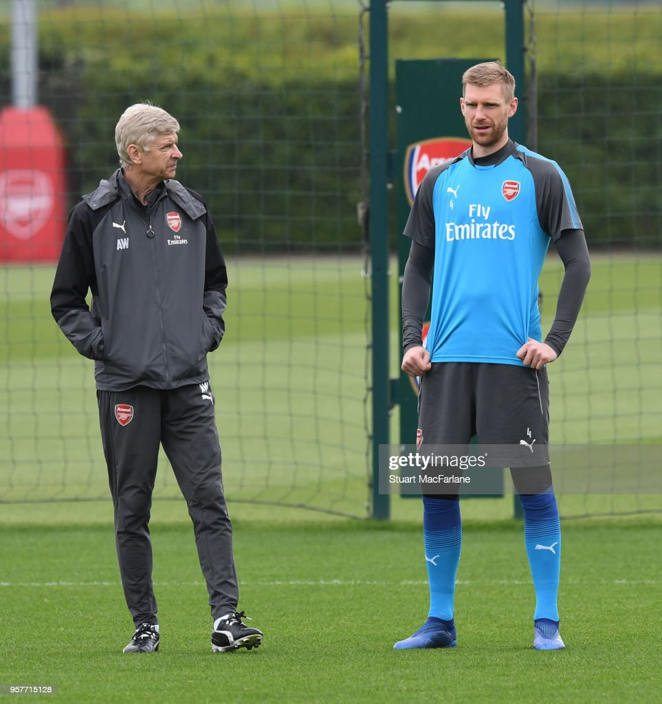 Arsenal manager Arsene Wenger with Per Mertesacker during a training session at London Colney on May 12, 2018 in St Albans, England.