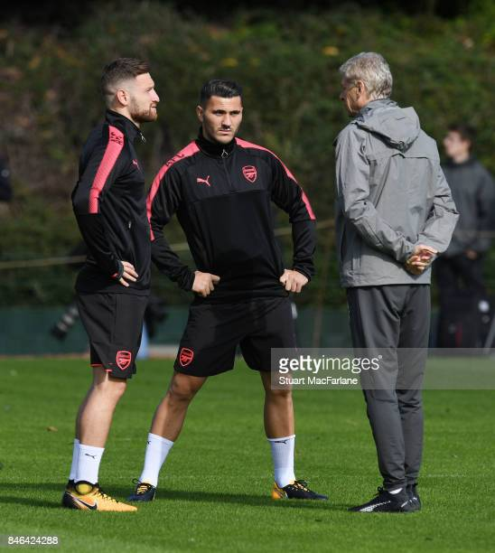 Arsenal manager Arsene Wenger with Shkodran Mustafi and Sead Kolasinac during a training session at London Colney on September 13 2017 in St Albans...