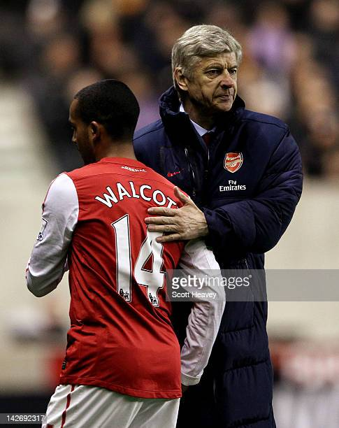 Arsenal manager Arsene Wenger with Theo Walcott during the Barclays Premier League match between Wolverhampton Wanderers and Arsenal at Molineux on...