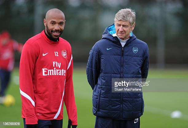 Arsenal manager Arsene Wenger with Thierry Henry of the New York Red Bulls during a training session at London Colney on December 30, 2011 in St...