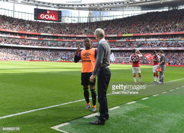 Arsenal manager Arsene Wenger with West Ham's Patrice Evra during the Premier League match between Arsenal and West Ham United at Emirates Stadium on...